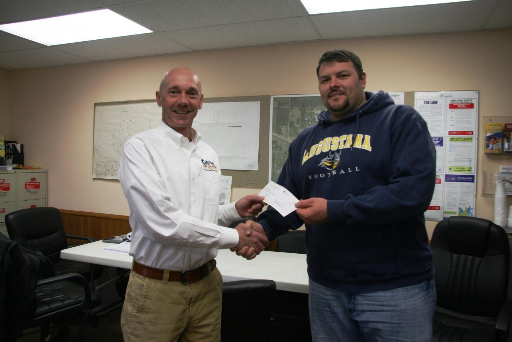 Central Electric Manager of Finance and Administration Scott Kroger (left) presents check to Mayor Joshua Kayser (right)