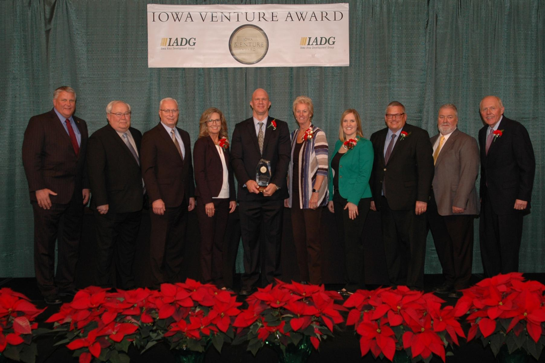Left to right: Jed Skogerboe, Jerry Beck, Rick Olesen of Iowa Lakes Electric Cooperative; Kellie Beneke, Josh Nelson, Candie Nelson, Greta Rouse of Great Lakes Communication Corp.; Iowa Secretary of Agriculture Bill Northey; Jack Schoon of Iowa Lakes Elec