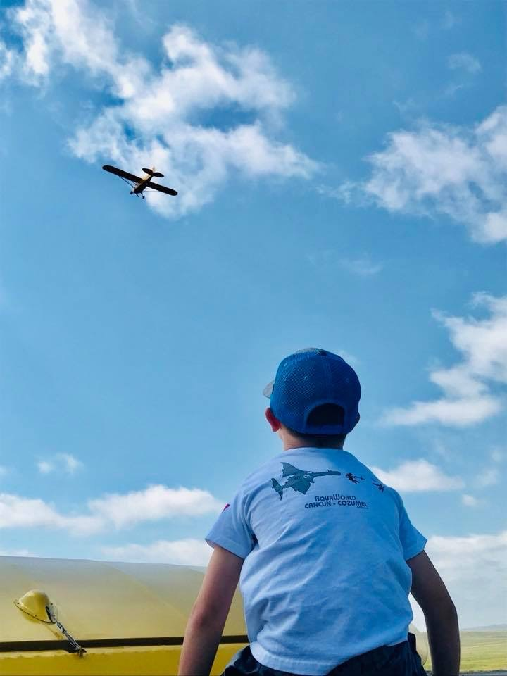 boy looking at plane