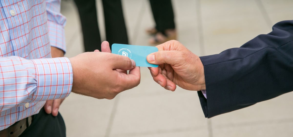 people sharing business cards