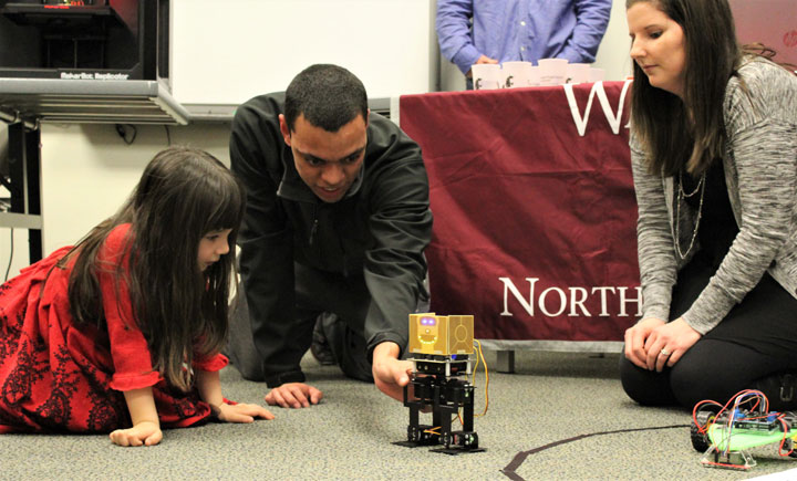 teacher demonstrating science experiment