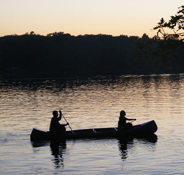 two people canoeing on a lake